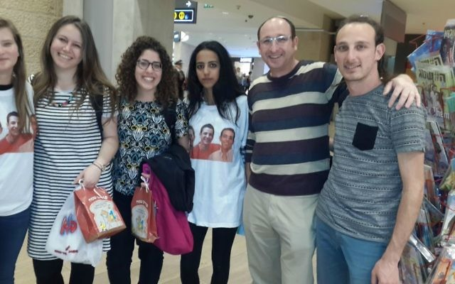 Ofir Shaer (second from right) with volunteers and Israeli travelers at Ben Gurion Airport, March 2017. (Courtesy)