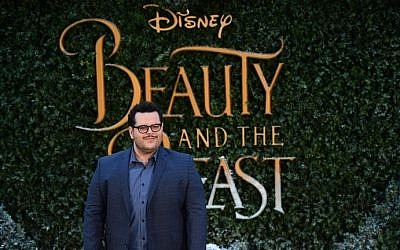 US actor Josh Gad poses upon arrival at the UK launch of the film 'Beauty and the Beast' in London on February 23, 2017. (AFP/Ben Stansall)