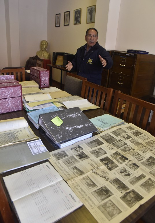 Edgar Ramirez, the head of the archives in the Bolivian state mining company COMIBOL, shows unearthed documents which reveal that Jewish-German tin baron Mauricio Hochschild helped thousands of Jews escape Nazism, in El Alto, Bolivia, on January 19, 2017. ( AFP PHOTO / AIZAR RALDES)