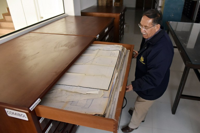 Edgar Ramirez, the head of the archives in the Bolivian state mining company COMIBOL, shows unearthed documents which reveal that Jewish-German tin baron Mauricio Hochschild helped thousands of Jews escape Nazism, in El Alto, Bolivia, on January 19, 2017. (Aizar Raldes/AFP)