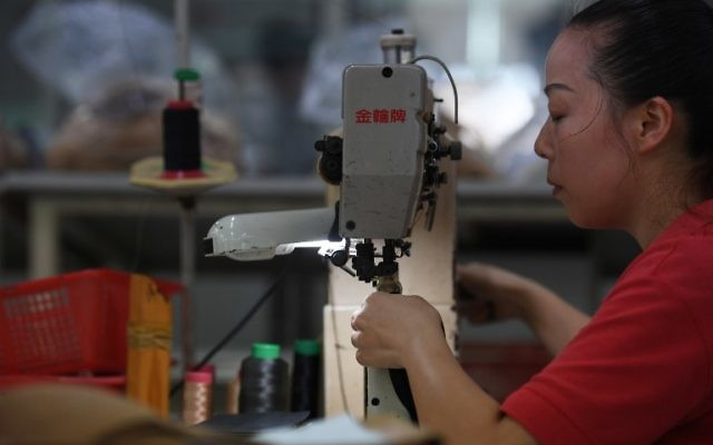This photo taken on September 14, 2016 shows a worker at the Huajian shoe factory, where about 100,000 pairs of Ivanka Trump-branded shoes have been made over the years amongst other brands, in Dongguan in south China's Guangdong province. (AFP PHOTO / Greg Baker)