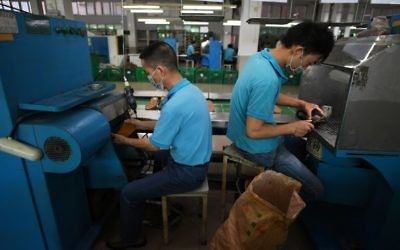 This photo taken on September 14, 2016 shows workers at the Huajian shoe factory, where about 100,000 pairs of Ivanka Trump-branded shoes have been made over the years amongst other brands, in Dongguan in south China's Guangdong province. (AFP PHOTO / Greg Baker)