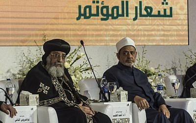 Egypt's Grand Imam of al-Azhar Sheikh Ahmed Mohamed al-Tayeb (R) and the leader of Egypt's Coptic Church, Pope Tawadros II of Alexandria attend a conference in Cairo, Egypt on February 28, 2017.(Khaled Desouki/AFP)