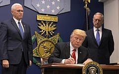 Illustrative: US President Donald Trump signing an executive order on January 27, 2017 at the Pentagon in Washington, DC. (AFP Photo/Mandel Ngan)