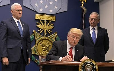 Illustrative: US President Donald Trump signing an executive order on January 27, 2017 at the Pentagon in Washington, DC. (AFP Photo/Mandel Ngan)