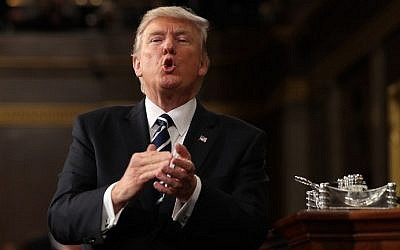 US President Donald J. Trump reacts after delivering his first address to a joint session of Congress from the floor of the House of Representatives in Washington, DC, USA, 28 February 2017. (AFP Photo/Pool/Jim Lo Scalzo)