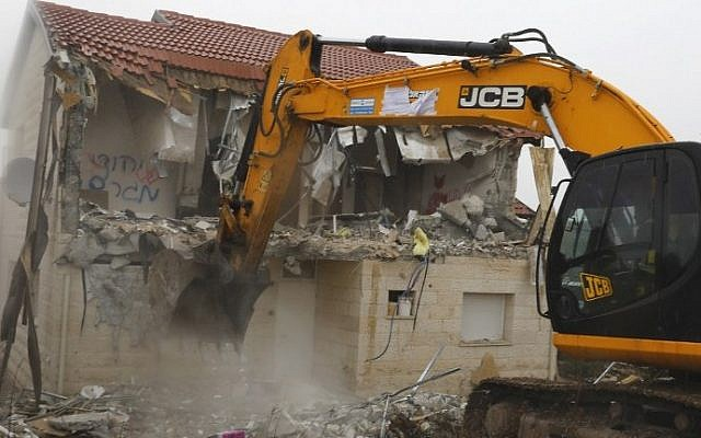 A bulldozer destroys a home built on private Palestinian land in the West Bank settlement of Ofra on March 1, 2017. (AFP Photo/Menahem Kahana)
