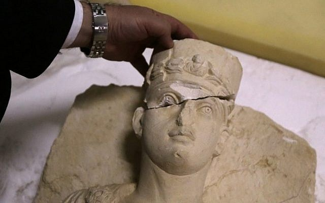 A picture taken at the National Museum in Damascus on March 1, 2017 shows a rare bust rescued from the Islamic State group in the ancient city of Palmyra awaiting to be restored, after it was returned to Syria. (AFP PHOTO / Louai Beshara)