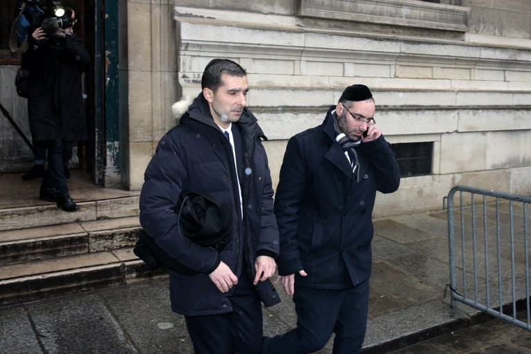 Benjamin Amsellem (R), a Jewish teacher who was stabbed by a 15-year-old student with a machete in January 2016, walks out of the Palais de Justice in Paris with his lawyer Fabrice Labi, during the teenager's trial at the juvenile court on March 1, 2017. (AFP PHOTO / GEOFFROY VAN DER HASSELT)
