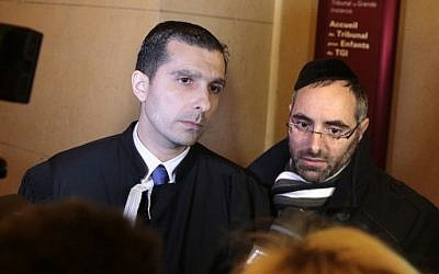 Benjamin Amsellem (R), a Jewish teacher who was stabbed by a 15-year-old student with a machete in January 2016, speaks to journalists, flanked by his lawyer Fabrice Labi, during the teenager's trial at the juvenile court of the Palais de Justice in Paris on March 1, 2017. (AFP/Geoffroy van der Hasselt)