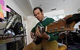 Australian musician Ben Lee rehearses inside his home studio in Los Angeles, California on March 2, 2017. (AFP PHOTO / Mark RALSTON)