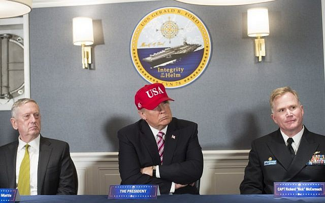 US President Donald Trump, center, Secretary of Defense James Mattis, left, and US Navy Captain Richard McCormack, right, attend an operations briefing at the pre-commissioned USS Gerald R. Ford aircraft carrier in Newport News, Virginia, March 2, 2017. (AFP Photo/Saul Loeb)