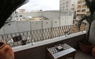 A picture taken from street artist Banksy's newly opened Walled Off hotel in the Israeli occupied West Bank town of Bethlehem, on March 3, 2017, shows Israel's controversial separation wall. (Thomas Coex/AFP)