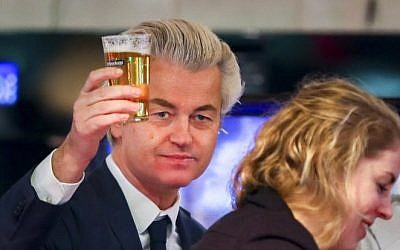 Dutch member of Parliament and leader of the far-right Party for Freedom (PVV) Geert Wilders, center, raises his glass in a cafe during a visit to the town of Volendam, on March 3, 2017, ahead of March 15 general elections. (AFP/ ANP / Jerry Lampen)