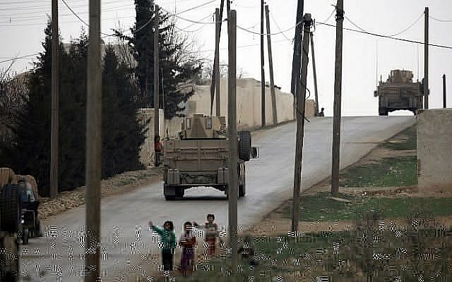 Manbij Military Council forces, part of the US-backed Syrian Democratic Forces (SDF), drive a humvee as they patrol the surrounding roads of in the northern Syrian town of Manbij on March 3, 2017. (AFP/Delil Souleiman)