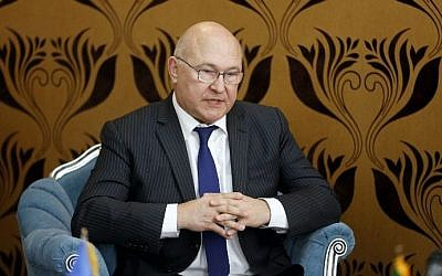 French Economy Minister Michel Sapin meets with Iran's Minister of Economic Affairs and Finance Ali Tayebnia in Tehran on March 4, 2017. (AFP Photo/Atta Kenare)
