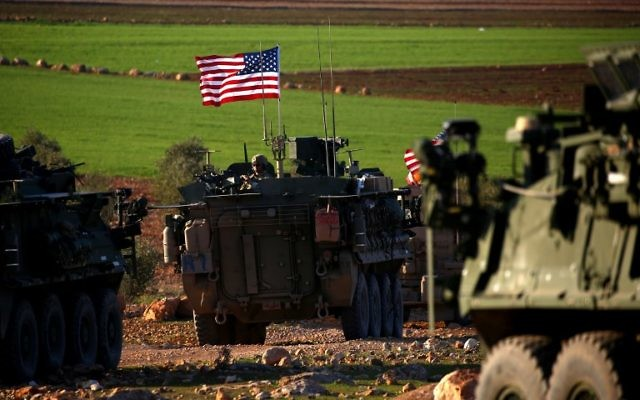 A convoy of US forces armored vehicles drives near the village of Yalanli, on the western outskirts of the northern Syrian city of Manbij, on March 5, 2017. (AFP Photo/Delil Souleiman)