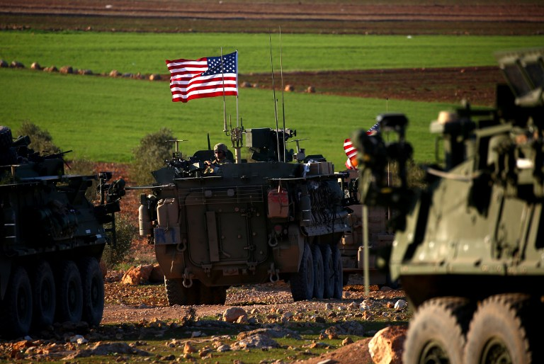 A convoy of US forces armored vehicles drives near the village of Yalanli, on the western outskirts of the northern Syrian city of Manbij, on March 5, 2017. (AFP PHOTO / DELIL SOULEIMAN)