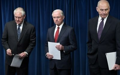 (L-R) US Secretary of State Rex Tillerson, Attorney General Jeff Sessions, and Homeland Security Secretary John Kelly arrive to deliver remarks on visa travel at the US Customs and Border Protection Press Room, in the Reagan Building, on March 6, 2017, in Washington, DC. (AFP PHOTO / MANDEL NGAN)