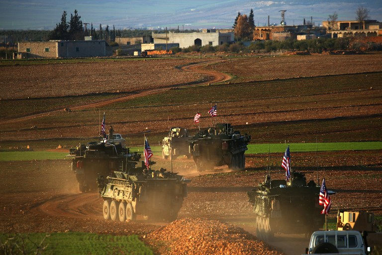 This file photo taken on March 5, 2017 shows a convoy of US forces armored vehicles driving near the village of Yalanli, on the western outskirts of the northern Syrian city of Manbij. (AFP Photo/Delil Souleiman)