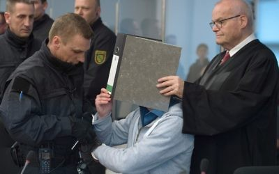 Defendant Justin S (C) are taken off the handcuffs as he waits for the start of his trial in Dresden, eastern Germany, on March 7, 2017. (Sebastian Kahnert/AFP)