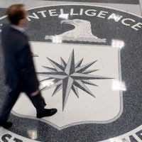 This file photo taken on August 13, 2008, shows a man walking over the seal of the Central Intelligence Agency (CIA) in the lobby of CIA headquarters in Langley, Virginia. (AFP/Saul Loeb)