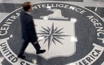 This file photo taken on August 13, 2008 shows a man walking over the seal of the Central Intelligence Agency (CIA) in the lobby of CIA headquarters in Langley, Virginia. (AFP/Saul Loeb)