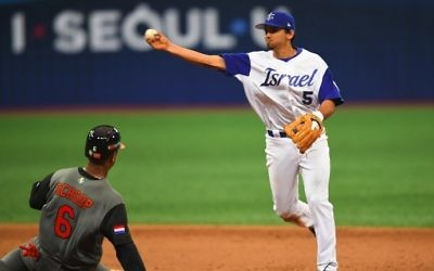 Infielder Scott Burcham (R) of Israel throws to the first base to make a double play against the Netherlands during the 8th inning of their first round game of the World Baseball Classic at Gocheok Sky Dome in Seoul on March 9, 2017. (AFP Photo/Jung Yeon-Je)