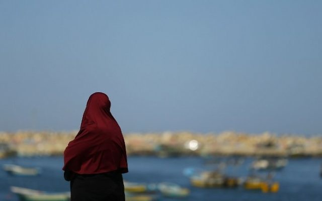 A woman looks at the sea as Palestinian families of fishermen shout slogans during a protest against Israel's blockade on the Gaza Strip on March 9, 2017 in Gaza City. (AFP/Mohammed Abed)