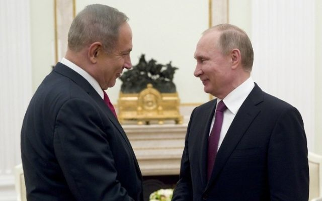 Prime Minister Benjamin Netanyahu, left, shakes hands with Russian President Vladimir Putin during their meeting in Moscow on March 9, 2017. (AFP Photo/Pool/Pavel Golovkin)