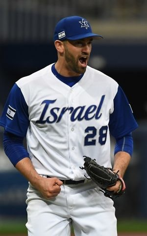 This file photo taken on March 9, 2017 shows pitcher Josh Zeid of Israel celebrating their victory against the Netherlands after their first round game of the World Baseball Classic at Gocheok Sky Dome in Seoul on March 9, 2017. ( AFP PHOTO / JUNG Yeon-Je)