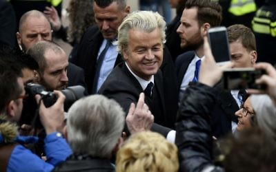 Dutch far-right Freedom Party leader (Partij Voor De Vrijheid, PVV) Geert Wilders is guarded by police as he meets with supporters in Heerlen on March 11, 2017. (AFP PHOTO / JOHN THYS)