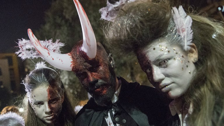 "People wearing costumes and face paint pose as they take part in a ""Zombie walk"" in Tel Aviv as part of the Jewish holiday of Purim on March 11, 2017. (JACK GUEZ / AFP)"