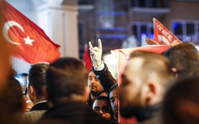 A demonstrator makes the nationalist 'grey wolves' sign during a gathering outside the Turkish consulate in Rotterdam, on March 11, 2017 after Netherlands refused Turkish Foreign Minister Mevlut Cavusoglu permission to land for a rally to gather support for a referendum on boosting Turkish president Erdogan's powers. (AFP PHOTO / ANP / Bas Czerwinski)