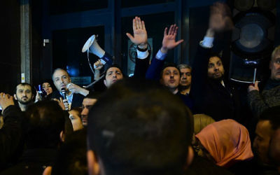 The Turkish ambassador to the Netherlands, second from left, addresses Turkish residents of the Netherlands gathered for a protest outside Turkey's consulate in Rotterdam on March 11, 2017. (Emmanuel Dunand/AFP)