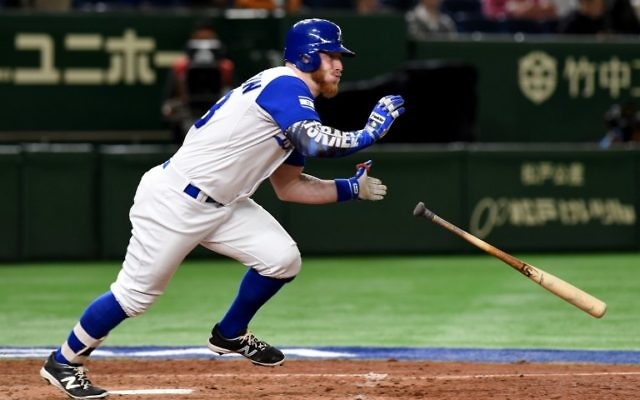Israeli right fielder Zach Borenstein hits a one-run single at the top of the sixth inning during the World Baseball Classic Pool E second round match between Cuba and Israel at Tokyo Dome in Tokyo on March 12, 2017. (AFP PHOTO / TORU YAMANAKA)