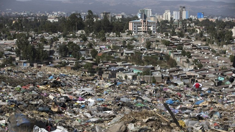 A photo taken on March 12, 2017 shows a view of Addis Ababa from the main landfill on the outskirts of the city, after a landslide at the dump left at least 35 people dead. (AFP Photo/Zacharias Abubeker)