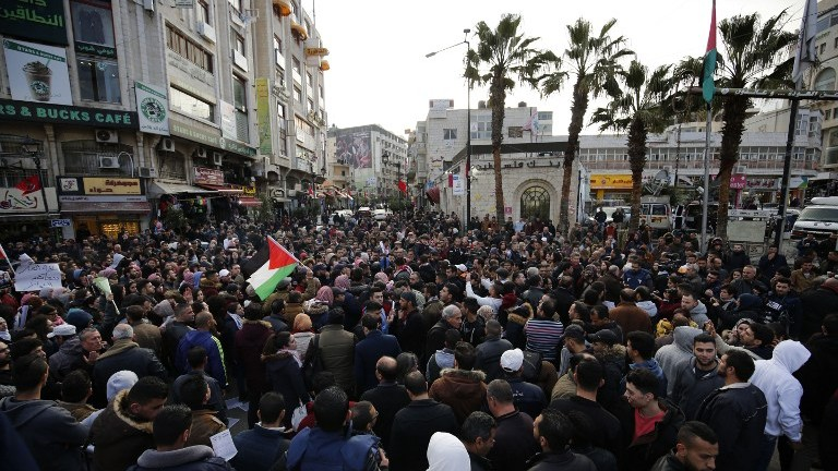 Palestinian demonstrators march in the West Bank city of Ramallah against the security coordination between PA security forces and Israel on March 13, 2017. (AFP Photo/Abbas Momani)