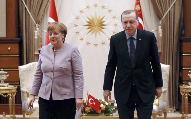 This file photo taken on February 2, 2017 shows Turkish President Recep Tayyip Erdogan (R) and German Chancellor Angela Merkel leaving after their meeting at the Presidential Palace in Ankara. (AFP PHOTO / ADEM ALTAN)