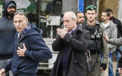 Israeli security forces arrest Palestinian researcher and cartographer Khalil Tufakji (C), director of the Office of Cartography, in the Beit Hanina neighborhood of east Jerusalem on March 14, 2017. (AFP PHOTO / AHMAD GHARABLI)