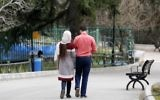 An Iranian couple walk in a park in the capital Tehran on March 14, 2017. (AFP/ATTA KENARE)