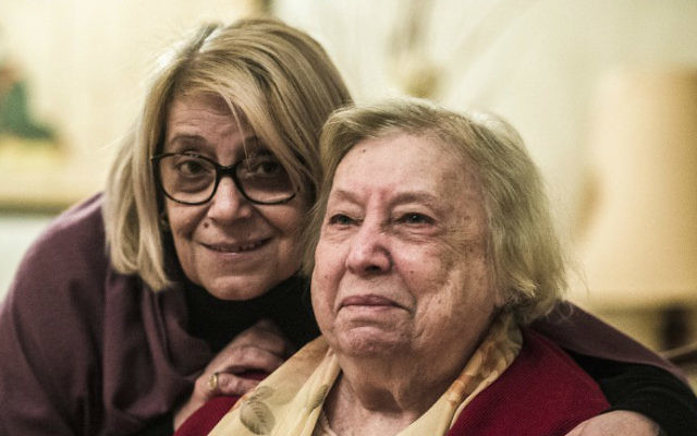 The president of the Egyptian Jewish Community Magda Shehata Haroun, left, and her mother Marcelle Haroun, right, pose for a picture during an interview at their home in Cairo on February 11, 2017. (Khaled Desouki/AFP)