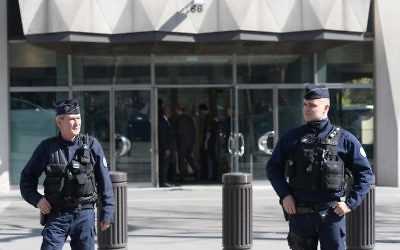 French Police officers stand guard outside the main entrance (Rear C) of the Paris offices of the International Monetary Fund (IMF) on March 16, 2017 in Paris, after a letter bomb exploded in the premises. (Christophe Archambault/AFP)