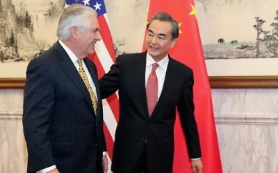 China's Foreign Minister Wang Yi (R) talks with US Secretary of State Rex Tillerson at the Diaoyutai State Guesthouse in Beijing on March 18, 2017. (AFP/Pool)