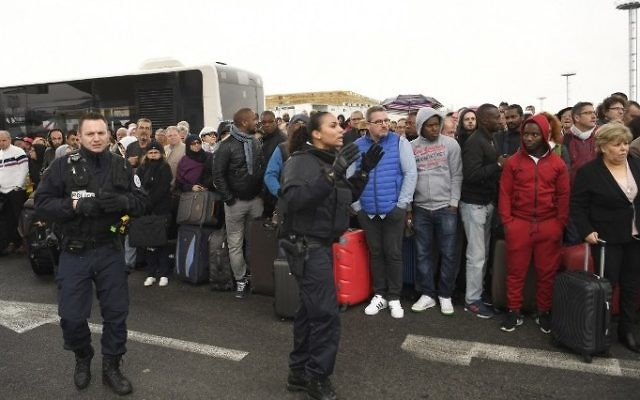 French police direct travellers as they are evacuated from Paris' Orly airport on March 18, 2017. (AFP/Christophe Simon)