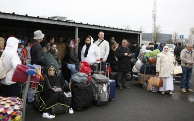 Travelers wait after being evacuated from Paris' Orly airport on March 18, 2017 following the shooting of a man by French security forces. Security forces shot dead a man who took a weapon from a soldier. Witnesses said the airport was evacuated following the shooting. (AFP PHOTO / Benjamin CREMEL)
