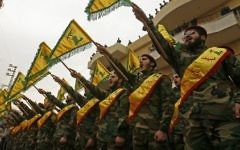 Fighters of the Shiite Hezbollah terror group attend the funeral in the southern Lebanese town of Kfar Hatta of a comrade who died in combat in Syria. March 18, 2017. (AFP Photo/ Mahmoud Zayyat)