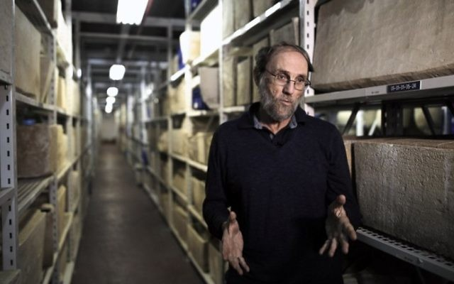 Professor Gideon Avni, head of the Archaeological Division in the Israel Antiquities Authority, speaks during a press tour at the national treasures storerooms of the Israel Antiquities Authority in Beit Shemesh on March 19, 2017. (AFP PHOTO / MENAHEM KAHANA)