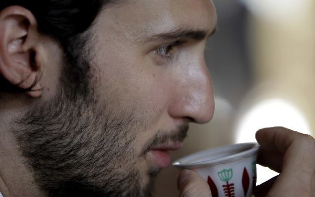Taymur Jumblatt, son of Lebanese Druze political leader Walid Jumblatt, drinking coffee during a farewell lunch for an Israeli-Arab Druze delegation at Jumblatt's residence in Mukhtara, southeast of Beirut, July 24, 2010 (AFP PHOTO / Joseph EID)