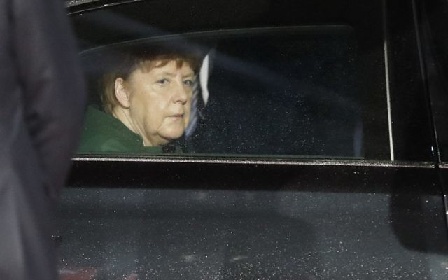 German Chancellor Angela Merkel arrives at the official opening of the CeBIT technology fair in Hanover, central Germany, on March 19, 2017.(AFP/Odd ANDERSEN)